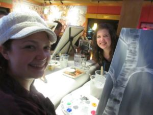 Rachel and Olivia painting at a Wine and Canvas event in 2017